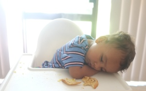 asleep in highchair